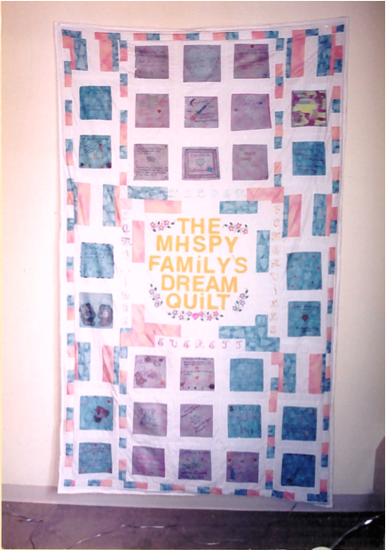 "Handmade quilt that says ""The MHSPY Family's Dream Quilt"""